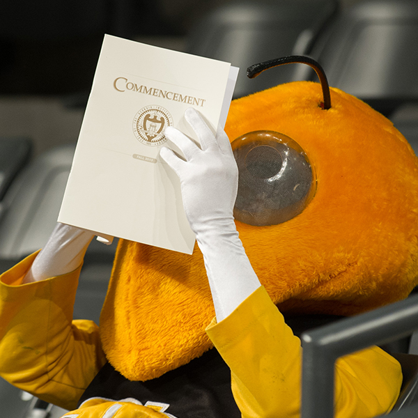 Buzz reading the Commencement program