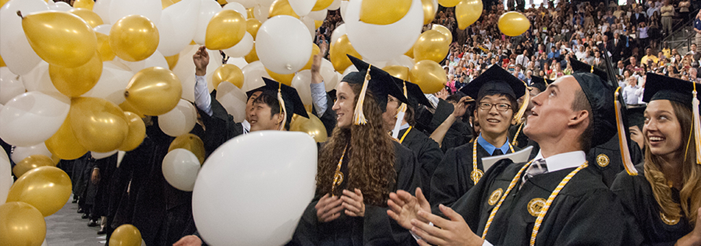 Happy graduates with balloons